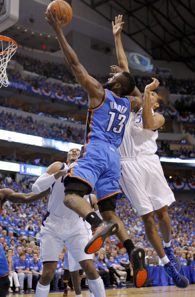 Photo - Oklahoma City's James Harden (13) goes past Dallas' Brandan Wright, at right, and Shawn Marion during Game 3 of the first round in the NBA playoffs between the Oklahoma City Thunder and the Dallas Mavericks at American Airlines Center in Dallas, Thursday, May 3, 2012. Photo by Bryan Terry, The Oklahoman