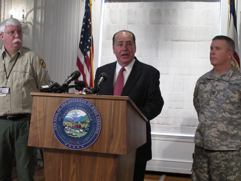 Photo - West Virginia Gov. Earl Ray Tomblin discusses the chemical  spill that led to state of emergency and water ban in the state capital and surrounding areas on Friday, Jan. 10, 2014, in Charleston, W.Va. (AP Photo/Brendan Farrington)