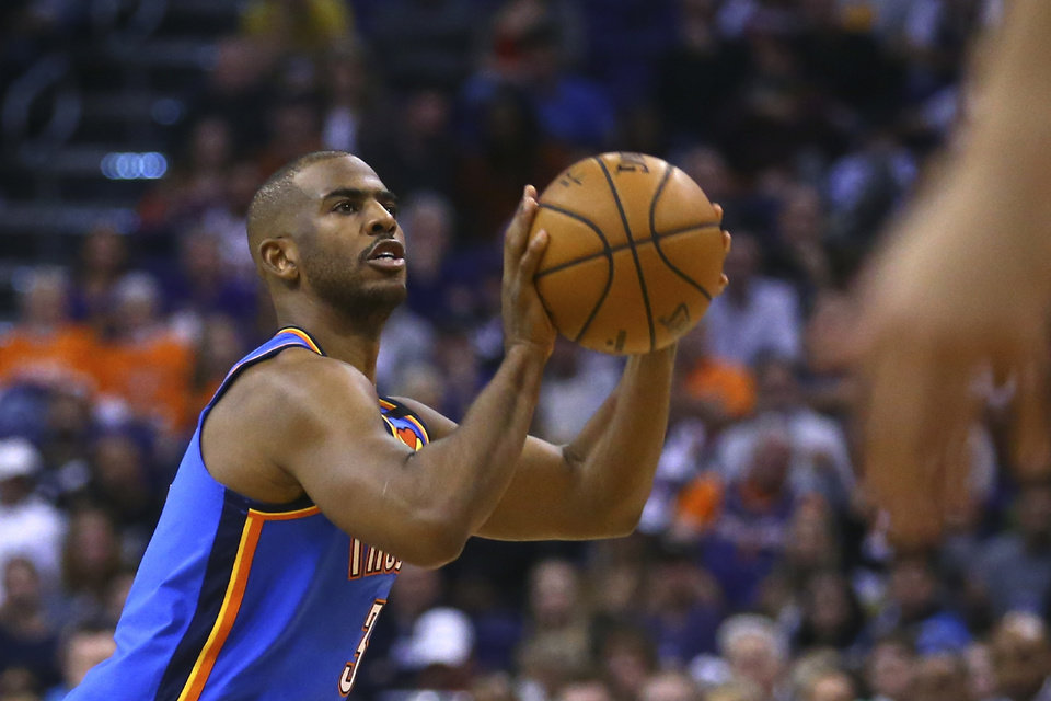 Photo - Oklahoma City Thunder guard Chris Paul looks to shoot against the Phoenix Suns during the first half of an NBA basketball game Friday, Jan. 31, 2020, in Phoenix. The Thunder defeated the Suns 111-107. (AP Photo/Ross D. Franklin)