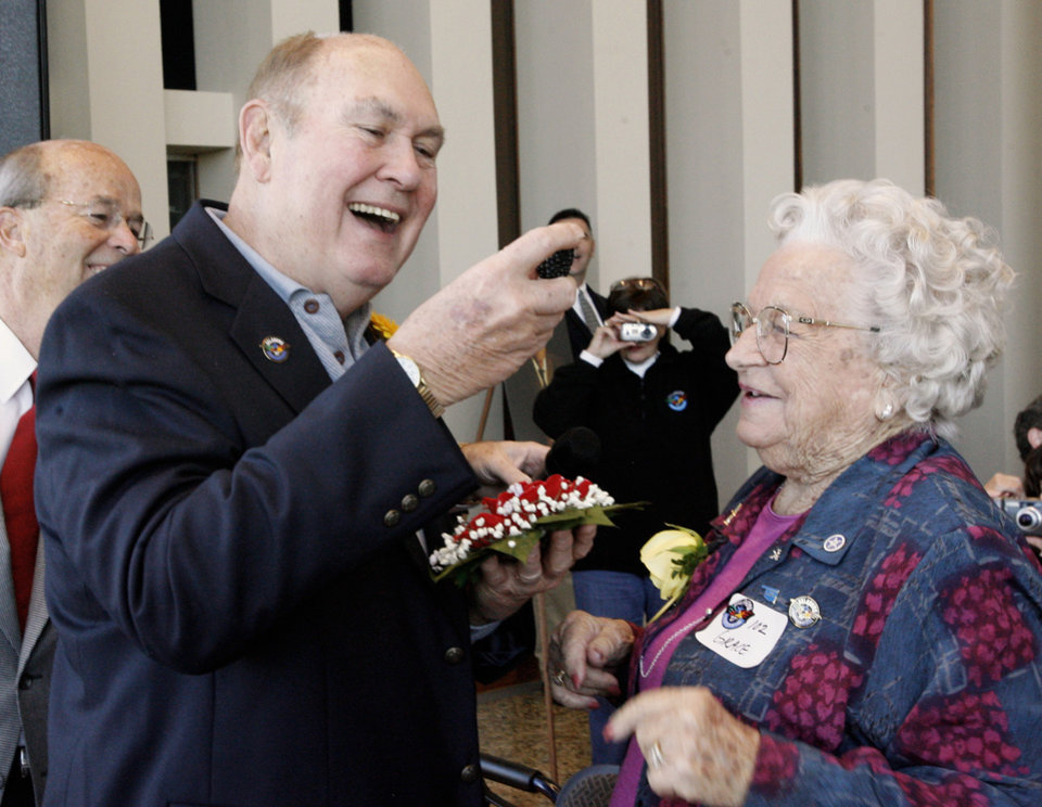Photo - Willard Scott receives a flower and an Oklahoma-grown blackberry from Grace Garoutte, Afton, 102, while attending the Centenarian Celebration held at the Oklahoma History Center during Oklahoma Statehood Day in Oklahoma City Friday, Nov. 16, 2007. By Paul B. Southerland, The Oklahoman