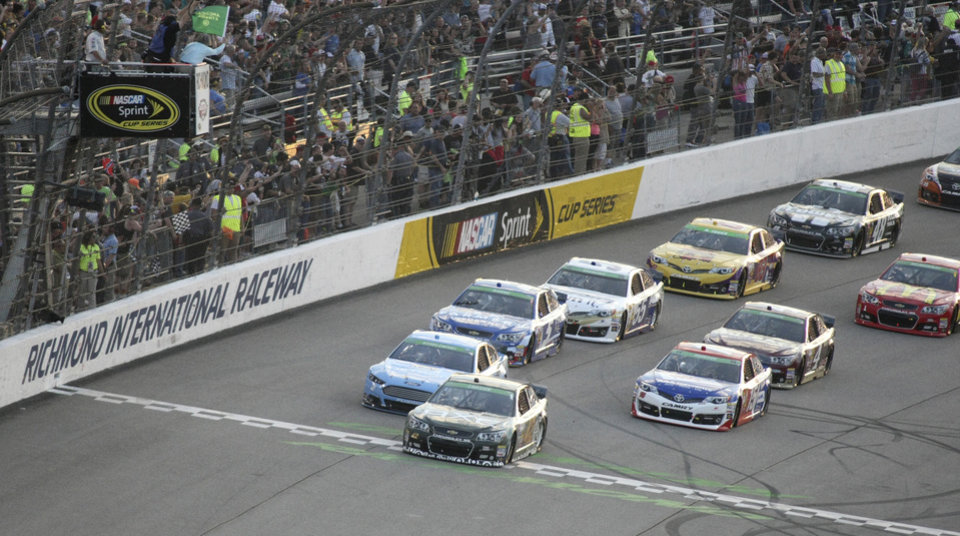 Photo - Kyle Larson (42) leads the field at the start of the NASCAR Sprint Cup auto race at Richmond International Raceway in Richmond, Va., Saturday, April 26, 2014. (AP Photo/Jason Hirschfeld)