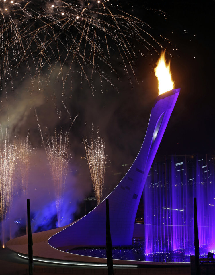Photo - Fireworks are seen over the Olympic Cauldron during the opening ceremony of the 2014 Winter Olympics in Sochi, Russia, Friday, Feb. 7, 2014. (AP Photo/Julio Cortez)