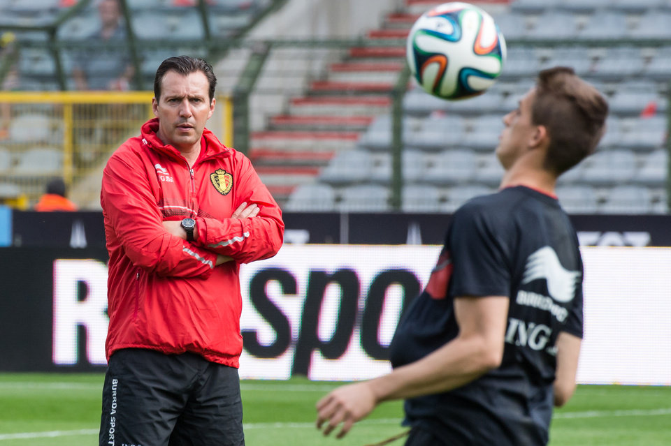 Photo - Belgium's national soccer coack Marc Wilmots, left, looks at Adnan Januzaj controlling the ball during their last training in Belgium before leaving for Brazil at the King Baudouin stadium in Brussels, Sunday June 8, 2014. Belgium will play against South Korea, Russia and Algeria in Group H of the World Cup 2014 in Brazil. (AP Photo/Geert Vanden Wijngaert)