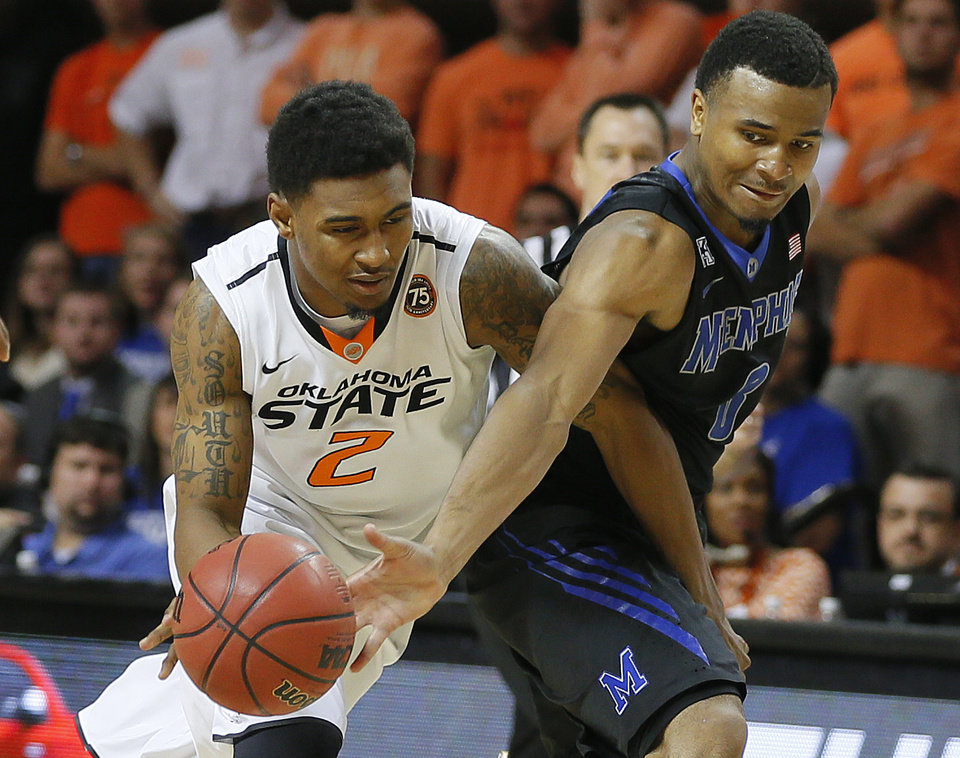 Photo - Oklahoma State's Le'Bryan Nash (2) tries to get past Memphis' Chris Crawford (3) during an NCAA college basketball game between Oklahoma State and Memphis at Gallagher-Iba Arena in Stillwater, Okla., Tuesday, Nov. 19, 2013. Photo by Bryan Terry, The Oklahoman