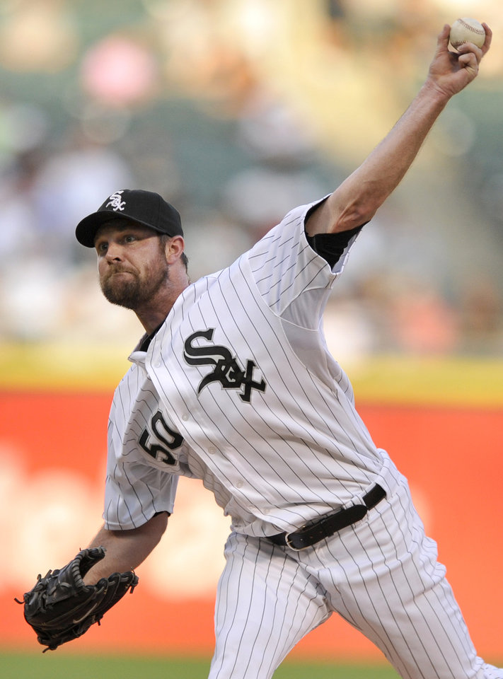 Photo - Chicago White Sox starter John Danks delivers a pitch during the first inning of a baseball game against the Atlanta Braves in Chicago, Friday, July 19, 2013. (AP Photo/Paul Beaty)