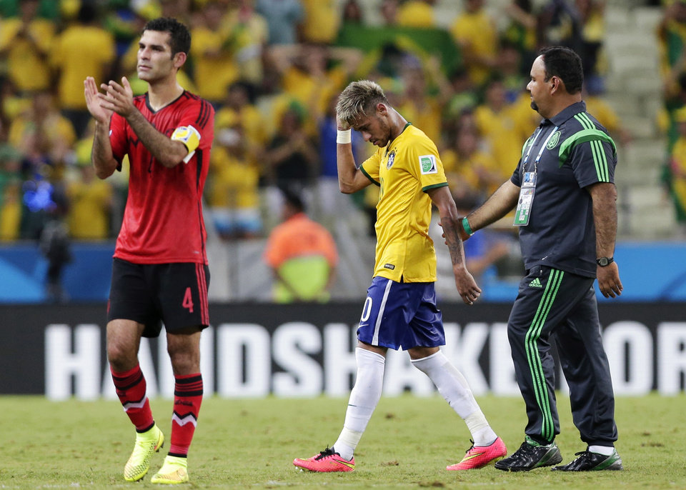 Photo - Mexico's Rafael Marquez, left, applauds as Brazil's Neymar walks off the pitch following their 0-0 tie during the group A World Cup soccer match between Brazil and Mexico at the Arena Castelao in Fortaleza, Brazil, Tuesday, June 17, 2014.  (AP Photo/Marcio Jose Sanchez)