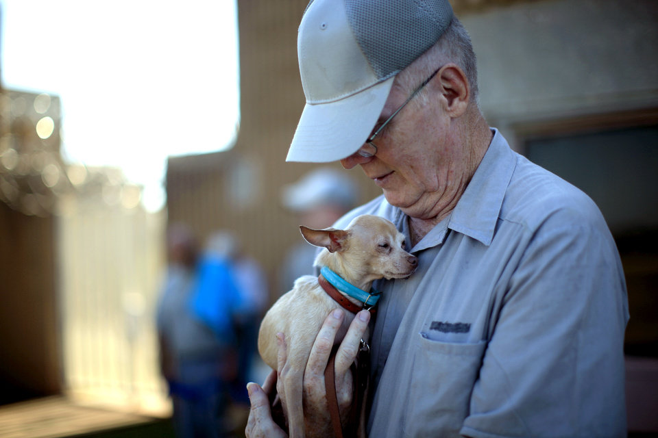 Inmate Bill Miller hugs Stanley at the Lexington Assessment and Reception Center, Friday, July 11,  2013, in Lexington, Okla. Photo by Sarah Phipps, The Oklahoman