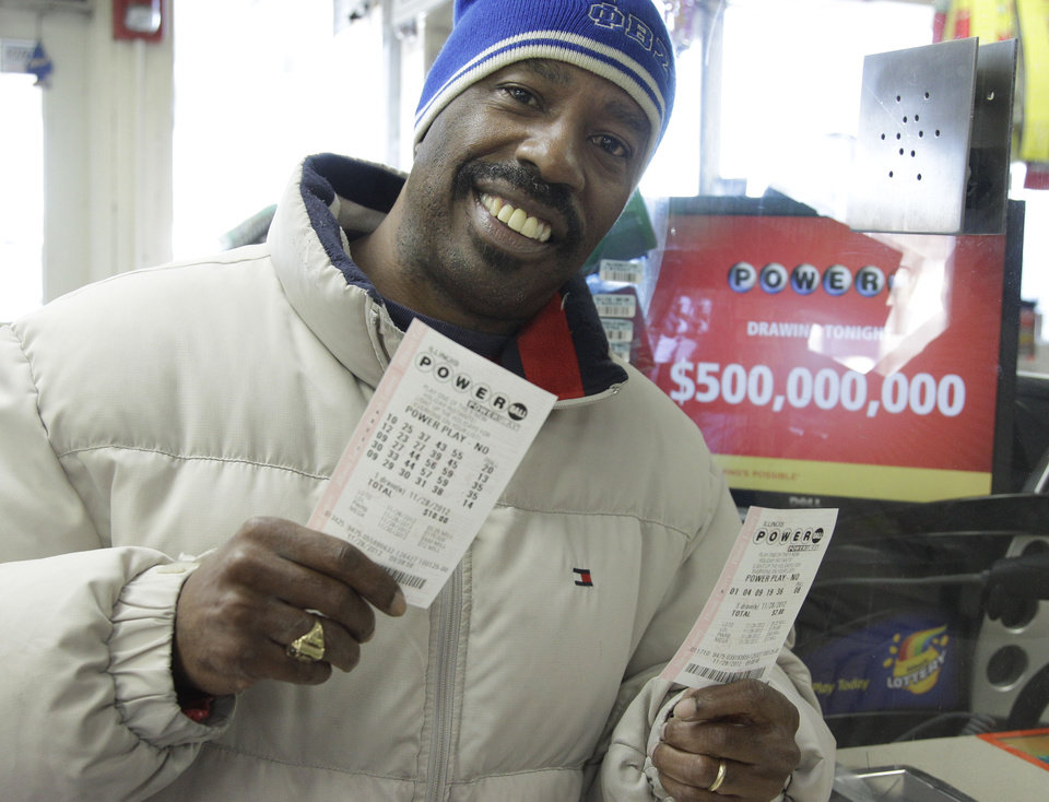 Photo -   Lamar Fallie, 52, of Chicago buys six Powerball tickets at a BP gas station Wednesday, Nov. 28, 2012 in Calumet Park, Ill. Fallie who is currently unemployed say he doesn't normally play the lottery but was lured by tonight's 500 million dollar jackpot. If he wins he says he will take care of his church first, then every child Beasley Elementary School will get a laptop, he will make a donation to Julian High School then he will retire from being unemployed. (AP Photo/M. Spencer Green)