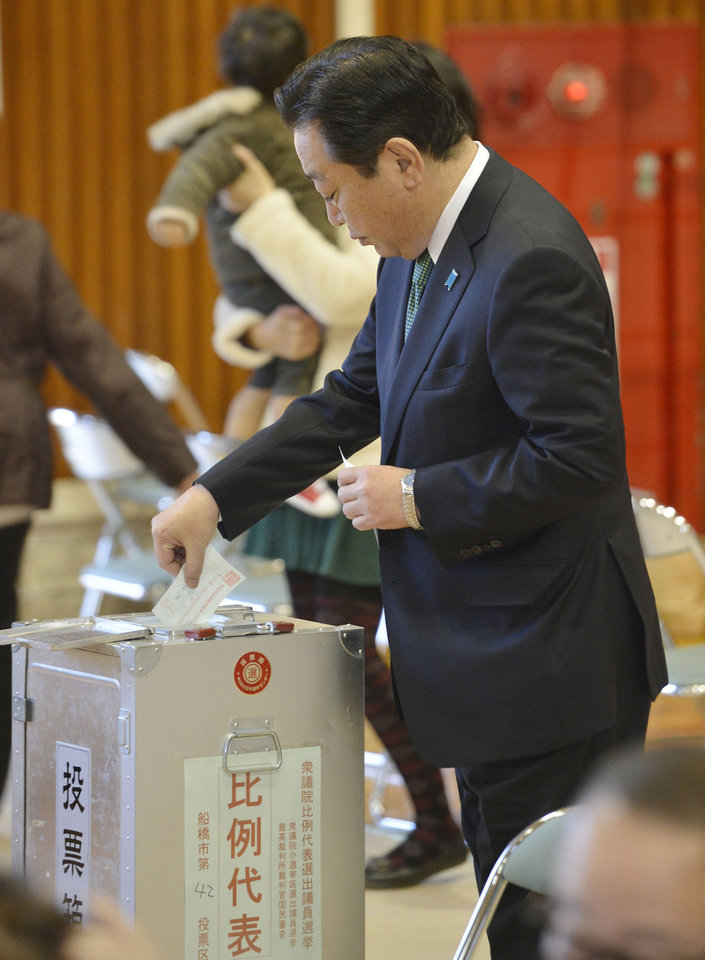 Japanese Prime Minister Yoshihiko Noda of the ruling Democratic Party of Japan casts his ballot for parliamentary elections in Funabashi in Chiba Prefecture, east of Tokyo, Sunday, Dec. 16, 2012. Japanese were voting Sunday, Dec. 16 in parliamentary elections that were expected to put the once-dominant conservatives back in power after a three-year break � and bring in a more nationalistic government amid tensions with big neighbor China. (AP Photo/Kyodo News) JAPAN OUT, MANDATORY CREDIT, NO LICENSING IN CHINA, HONG KONG, JAPAN, SOUTH KOREA AND FRANCE