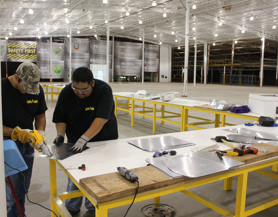 Photo - Robert Botone and Geoff Haumpo work in the Unami LLC factory in Anadarko.    - PROVIDED BY DELAWARE NATION ECON