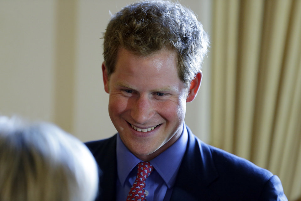 Photo - England's Prince Harry greets attendees before a reception and dinner at the British Ambassador's residence, Thursday, May 9, 2013 in Washington. (AP Photo/Alex Brandon, Pool)