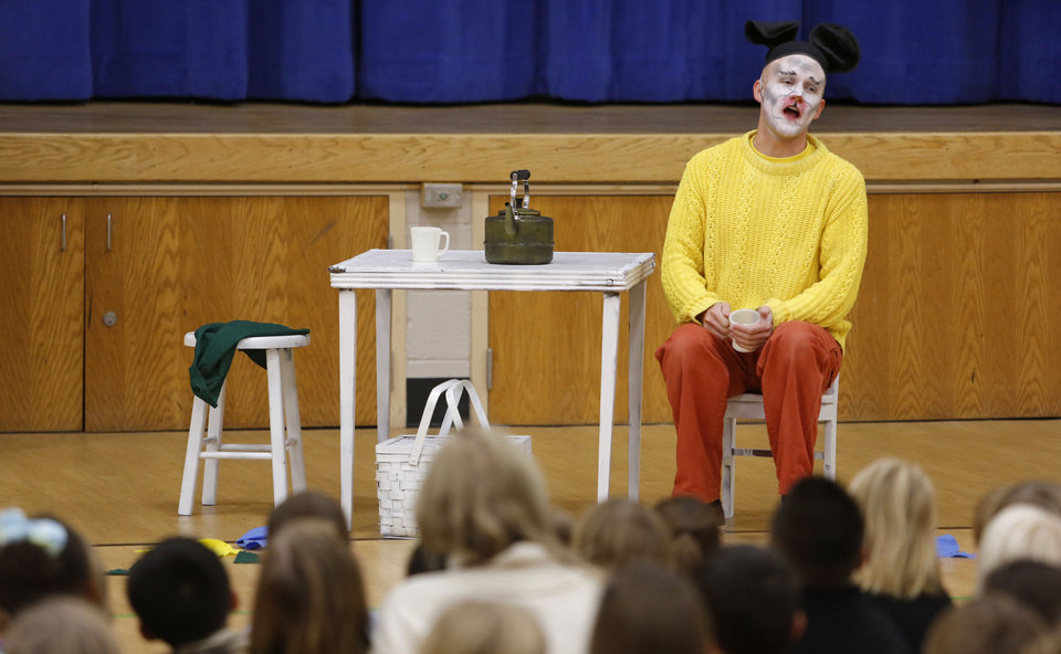 "Photo - Zac Engle with the Tulsa Opera portrays ""Mooch the Messy"" at Monroe Elementary in Norman. The performance was part of the group's annual ""Opera on Tour!"" event. ""Mooch the Messy"" is a 30-minute children's opera by Marcus DeLoach based on the 1976 children's book by Marjorie Weinman Sharmat.  PHOTOS BY STEVE GOOCH, THE OKLAHOMAN"