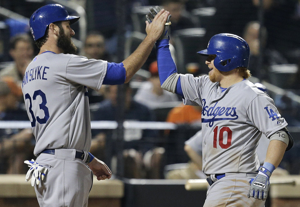 Photo - Los Angeles Dodgers' Justin Turner (10) is greeted by Scott Van Slyke (33) after hitting a two-run home run against the New York Mets during the seventh inning of a baseball game, Thursday, May 22, 2014, in New York. (AP Photo/Julie Jacobson)