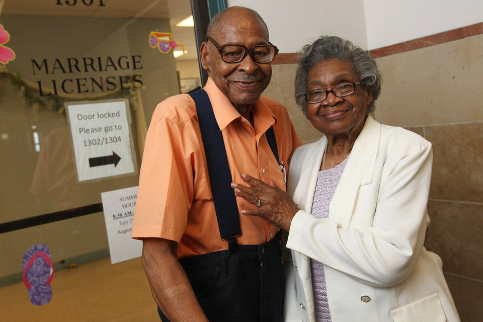 In a Monday, July 23, 2012 photo, Roland Davis of Colorado, left, and Lena Henderson of West Seneca, N.Y. pose for a photo at the Buffalo City Hall. DAvis and Henderson were divorced 50 years ago in Georgia. At 85, they are remarrying. They went to City Hall to get their marriage license,, for their August 4 wedding. (AP Photo/Buffalo News, Sharon Cantillon) (AP Photo/The Buffalo News, ) TV OUT; MAGS OUT; MANDATORY CREDIT; BATAVIA DAILY NEWS OUT; DUNKIRK OBSERVER OUT; JAMESTOWN POST-JOURNAL OUT; LOCKPORT UNION-SUN JOURNAL OUT; NIAGARA GAZETTE OUT; OLEAN TIMES-HERALD OUT; SALAMANCA PRESS OUT; TONAWANDA NEWS OUT