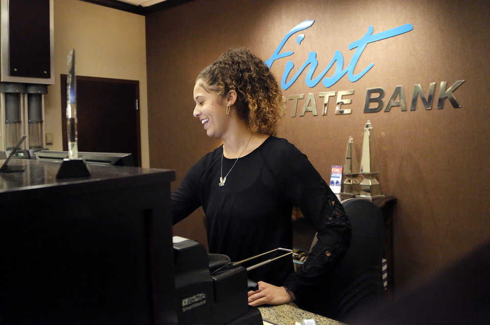 Photo -  McKenna Henry works at The First State Bank in Oklahoma City. [Photo by Sarah Phipps, The Oklahoman]