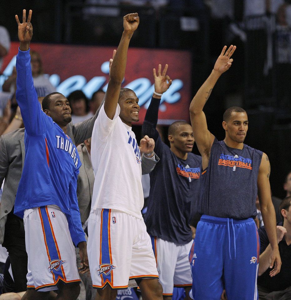 REACTION: Oklahoma City's Serge Ibaka (9), Kevin Durant (35), Russell Westbrook (0), and Thabo Sefolosha (2) react during game five of the Western Conference semifinals between the Memphis Grizzlies and the Oklahoma City Thunder in the NBA basketball playoffs at Oklahoma City Arena in Oklahoma City, Wednesday, May 11, 2011. Photo by Bryan Terry, The Oklahoman ORG XMIT: KOD