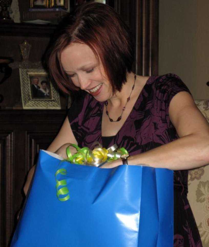 HE'S A BOY....Kirsten checks out the gifts at the shower in her honor. Hostesses were Jenny Kalsu, Shelly Lambertz, Michelle Ponder, Lauri Gormley, Mary Beth Griffing, Kim Collins, Amy Feuerborn, Kimberly Ross, Melissa Santoro and Kristin Racz. (Photo by Helen Ford Wallace).