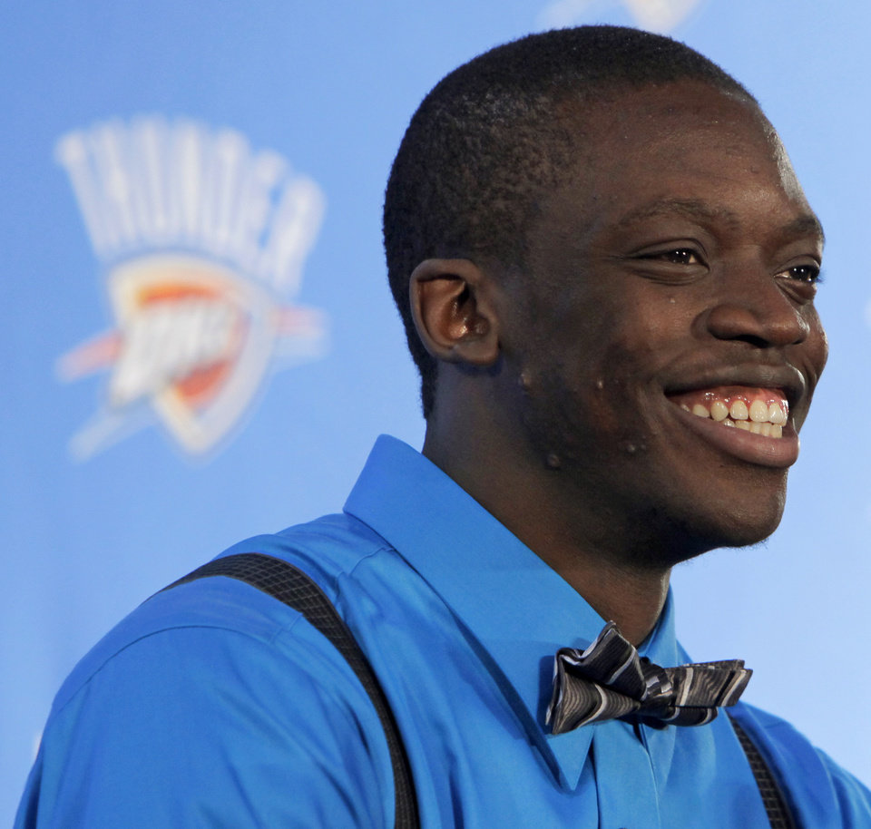 Photo - Oklahoma City Thunder draft pick Reggie Jackson smiles during a news conference at the Boys and Girls Club of Oklahoma County in Oklahoma City, Saturday, June 25, 2011. The Thunder selected Reggie Jackson with the 24th pick in this year's NBA draft. Photo by Nate Billings, The Oklahoman