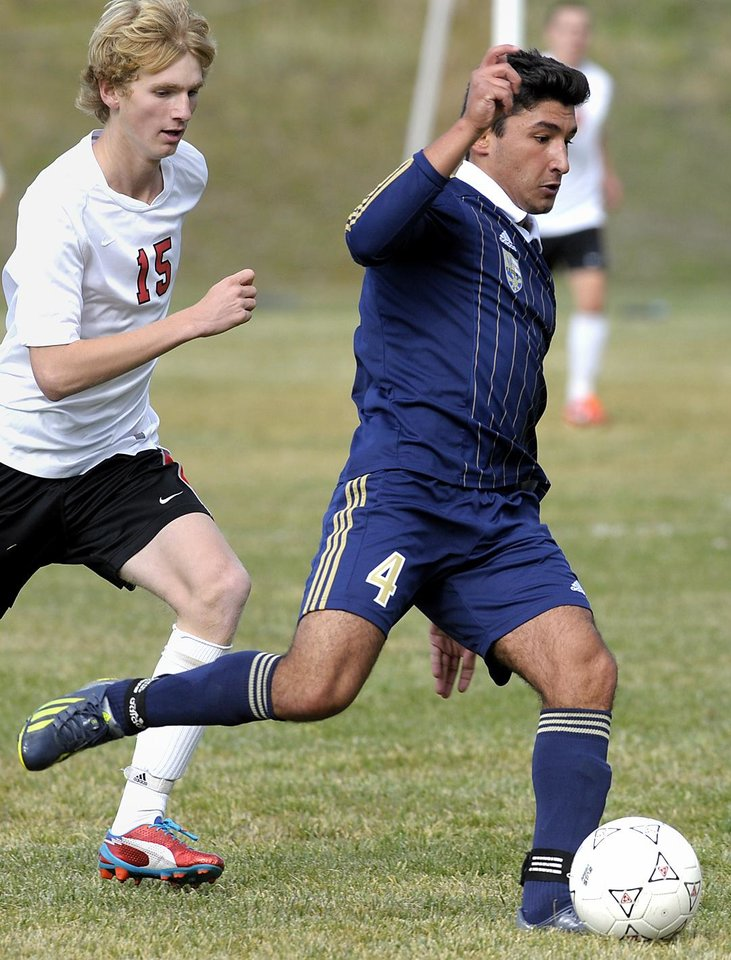 Photo - In this Oct. 8, 2013,  photo Diren Dede, right, plays in a Big Sky soccer game against Hellgate. Markus Kaarma, 29, was released from jail Monday, April 28, 2014,  after posting a $30,000 bond on a charge of deliberate homicide in the death of Diren Dede of Hamburg, Germany.  (AP Photo/The Missoulian, Tom Bauer)