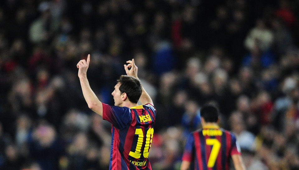 Photo - FC Barcelona's Lionel Messi, from Argentina, reacts after scoring against Rayo Vallecano during a Spanish La Liga soccer match at the Camp Nou stadium in Barcelona, Spain, Saturday, Feb. 15, 2014. (AP Photo/Manu Fernandez)