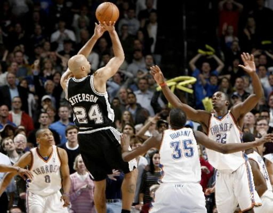 Photo - San Antonio's Richard Jefferson shoots the game-winning basket over Oklahoma City's Russell  Westbrook, left, Kevin  Durant, and Jeff  Green during the NBA basketball game between the Oklahoma City Thunder and the San Antonio Spurs at the Ford Center in Oklahoma City, Wednesday, January 13, 2010. Photo by Bryan Terry
