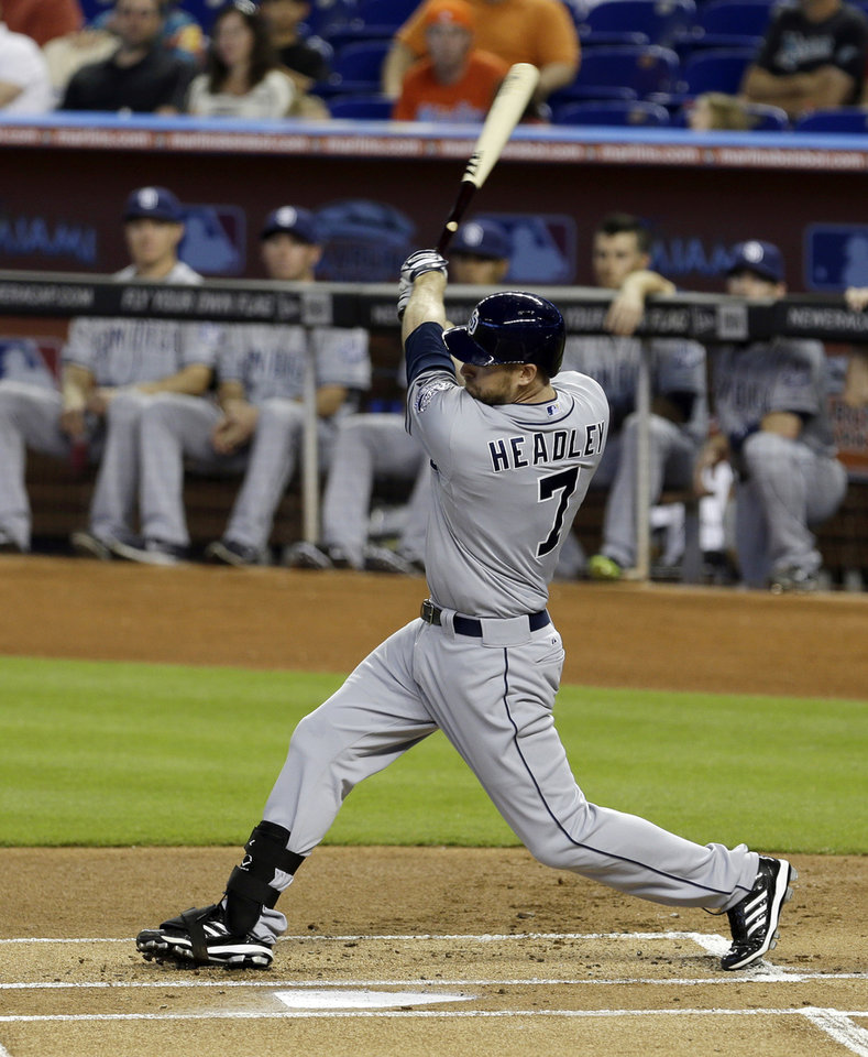 San Diego Padres\' Chase Headley follows through on a base hit against the Miami Marlins in the first inning of a baseball game in Miami, Sunday, April 6, 2014. (AP Photo/Alan Diaz)