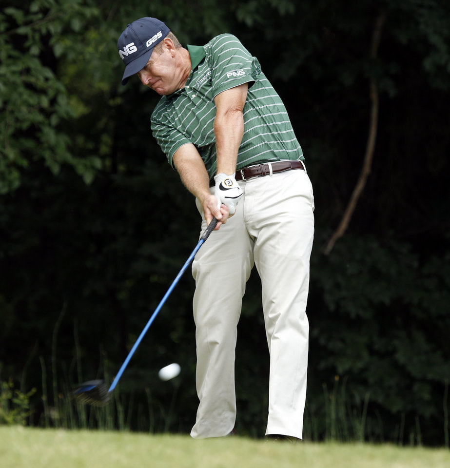 Photo - Jeff Maggert hits on hole 7 during the first round of the U.S. Senior Open Championship golf tournament at Oak Tree National in Edmond, Okla. on Thursday, July 10, 2014. Photo by Steve Sisney, The Oklahoman
