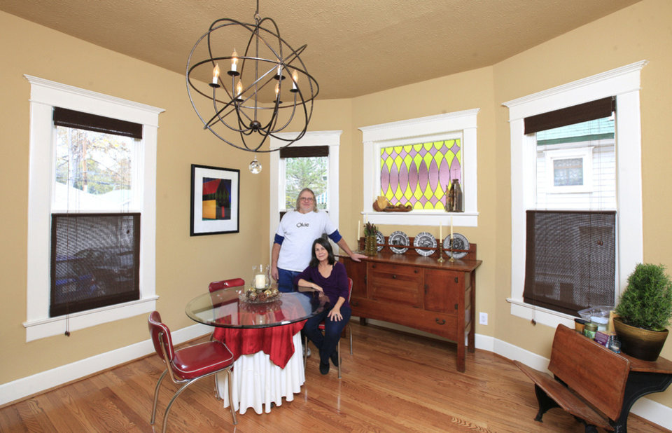 Photo - Steve and Lynette Mathis show their dining room at 819 NW 16. Their home is one of several on the Mesta Park Holiday Home Tour next weekend.  PAUL B. SOUTHERLAND - The Oklahoman