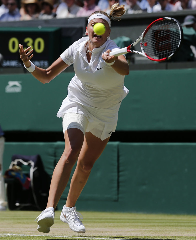 Photo - Petra Kvitova of Czech Republic stretches to play a return to Lucie Safarova of Czech Republic during their women's singles semifinal match at the All England Lawn Tennis Championships in Wimbledon, London, Thursday, July 3, 2014. (AP Photo/Ben Curtis)