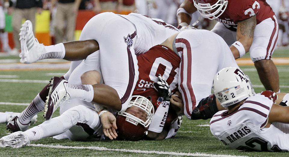 Photo - Oklahoma's Blake Bell (10) is rolled up short of the endzone during the college football Cotton Bowl game between the University of Oklahoma Sooners (OU) and Texas A&M University Aggies (TXAM) at Cowboy's Stadium on Friday Jan. 4, 2013, in Arlington, Tx. Photo by Chris Landsberger, The Oklahoman