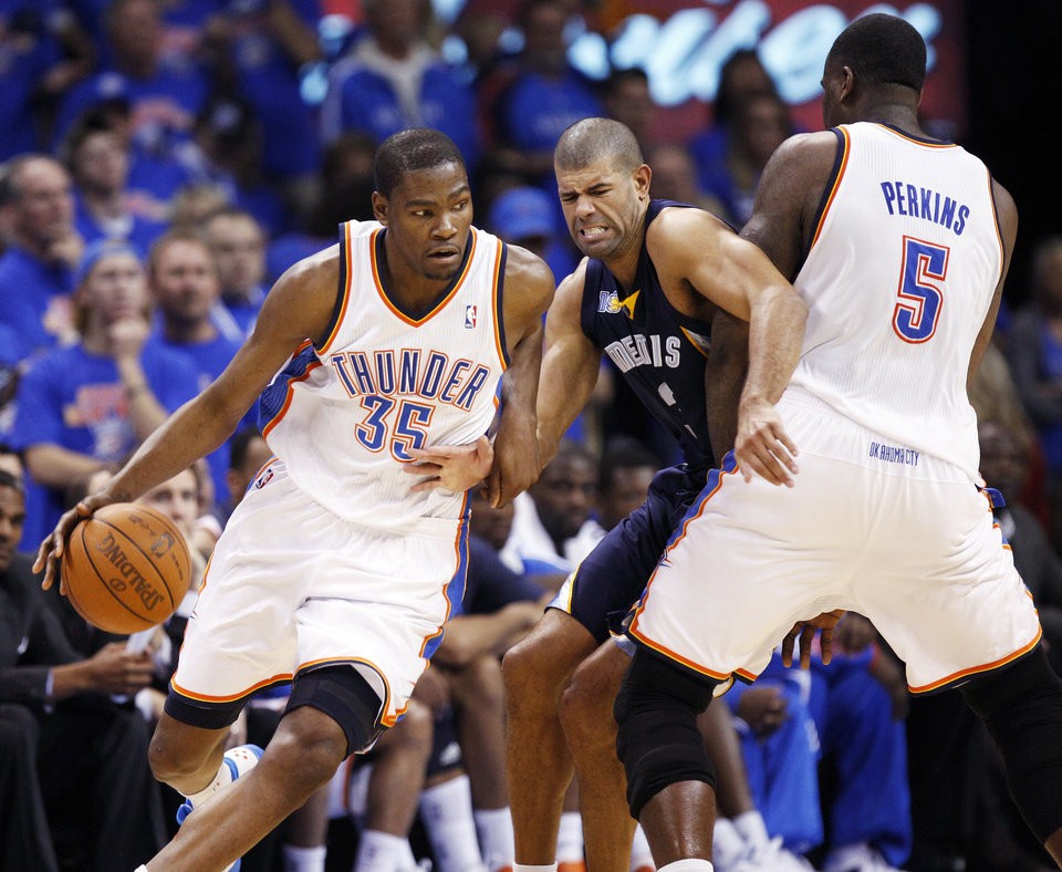Oklahoma City's Kevin Durant (35) dribbles past Shane Battier (31) of Memphis as Kendrick Perkins (5) of Oklahoma City sets a screen in the second half during game 7 of the NBA basketball Western Conference semifinals between the Memphis Grizzlies and the Oklahoma City Thunder at the OKC Arena in Oklahoma City, Sunday, May 15, 2011. The Thunder won, 105-90. Photo by Nate Billings, The Oklahoman
