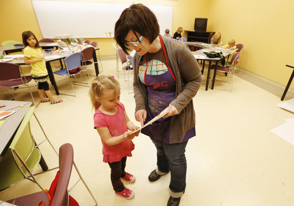 Hannah Wright, 5, shows her photo-realism art project to art instructor Amanda Harmer during spring break art camp at the Oklahoma City Museum of Art. A second week of camp starts Tuesday. Photos By Steve Gooch, The Oklahoman
