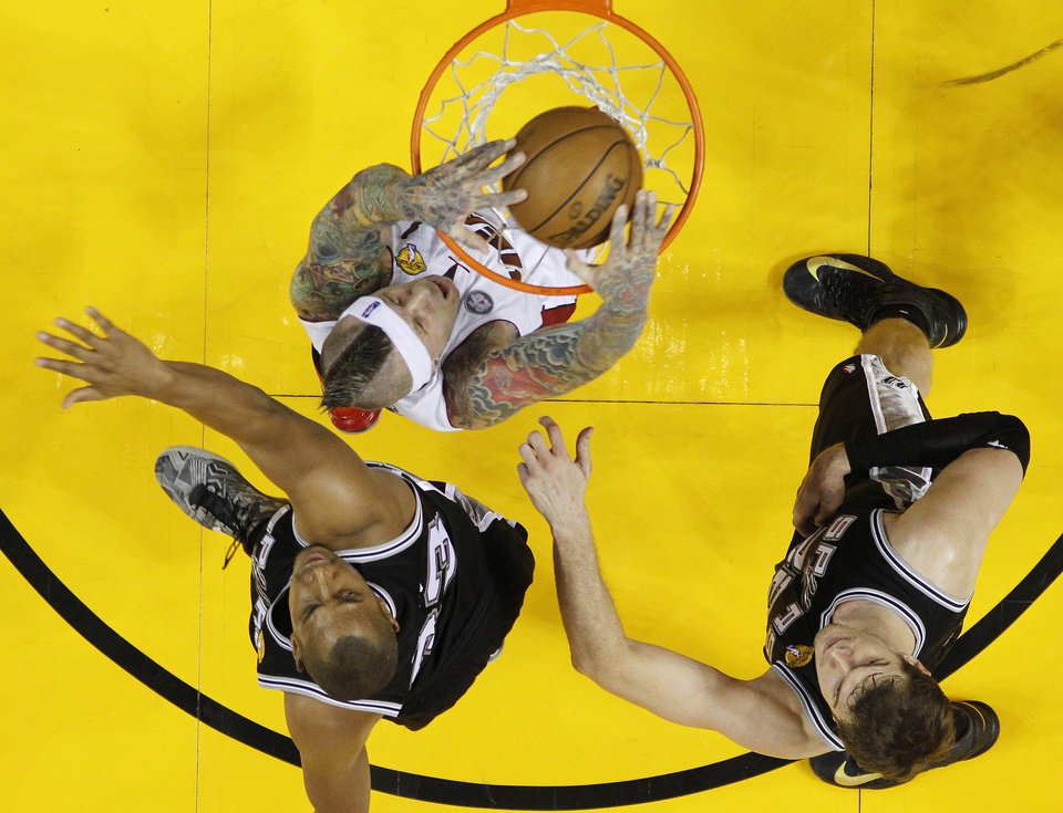 Photo - Miami Heat power forward Chris Andersen (11) dunks the ball as San Antonio Spurs center Boris Diaw (33) of France and San Antonio Spurs center Tiago Splitter (22) of Brazil look on during the first half of Game 2 in the NBA Finals basketball game, Sunday, June 9, 2013 in Miami. (AP Photo/Mike Segar, Pool)