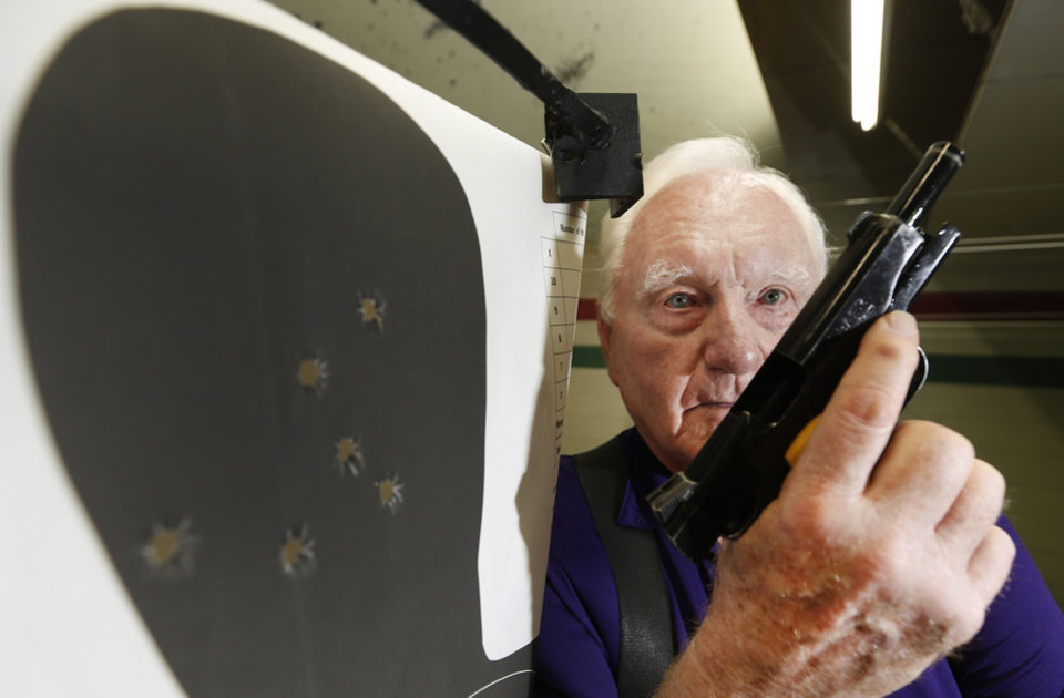Photo - Retired Air Force Col. Thomas D. Smith III poses for a photo at H&H Shooting Sports Complex in Oklahoma City, Friday June 28, 2013. Col. Smith set a pistol shooting record in the Pan American Games in 1963 that still stands today. In all, he set 79 shooting records in his career and this summer marks the 50th anniversary of the Pan Am record. In 1966, he was awarded the Airman's Medal for extraordinary heroism when he survived a 5,000-feet freefall from a plane into the snow then cared for the wounded in the plane wreckage for two days until they were found. Photo By Steve Gooch, The Oklahoman