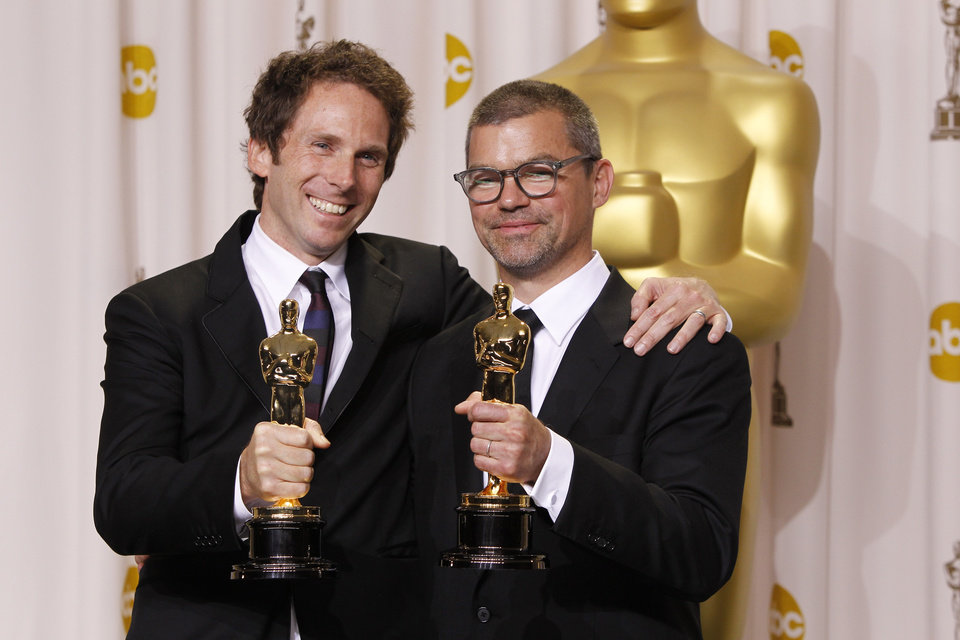 "** EMBARGOED AT THE REQUEST OF THE ACADEMY OF MOTION PICTURE ARTS & SCIENCES FOR USE UPON CONCLUSION OF THE ACADEMY AWARDS TELECAST **Kirk Baxter, left, and Angus Wall, pose with their awards for best achievement in film editing for ""The Girl with the Dragon Tatoo"" during the 84th Academy Awards on Sunday, Feb. 26, 2012, in the Hollywood section of Los Angeles. (AP Photo/Joel Ryan) ORG XMIT: ACATS154"