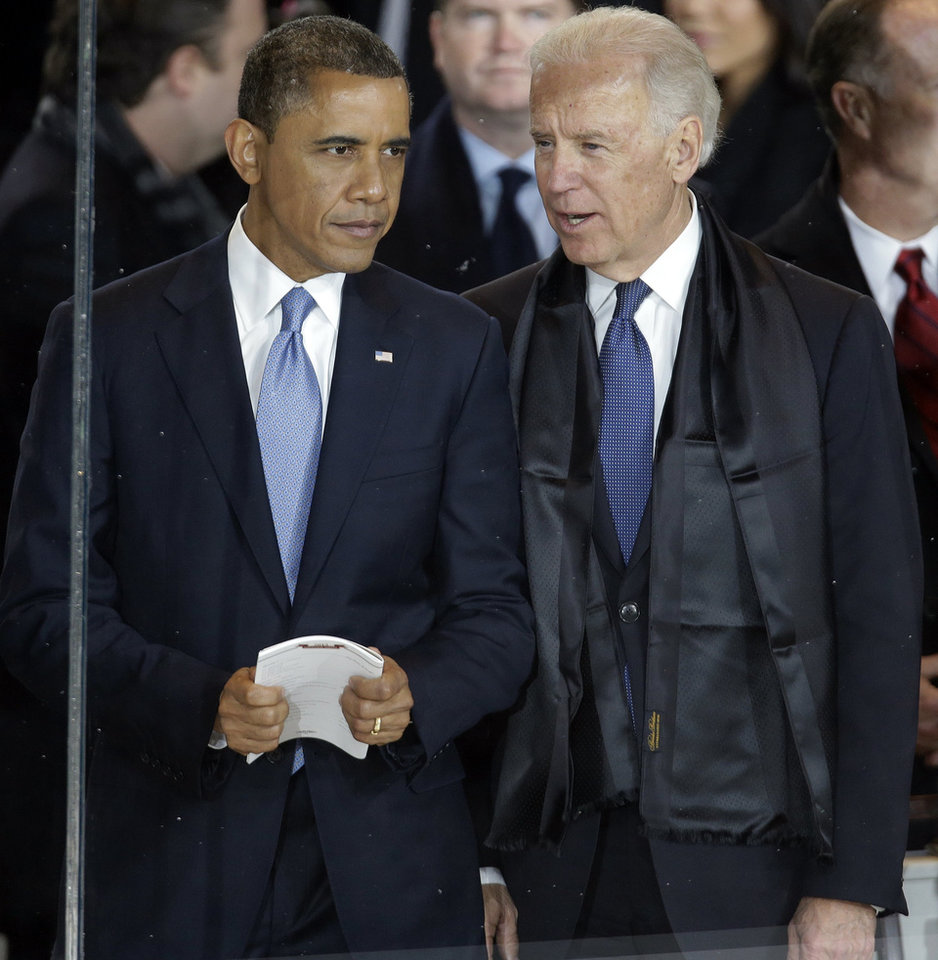 Photo - President Barack Obama talks with Vice President Joe Biden in the presidential box during the inaugural parade down Pennsylvania Avenue en route to the White House, Monday, Jan. 21, 2013, in Washington. Thousands  marched during the 57th Presidential Inauguration parade after the ceremonial swearing-in of President Barack Obama. (AP Photo/Gerald Herbert) ORG XMIT: DCMS168