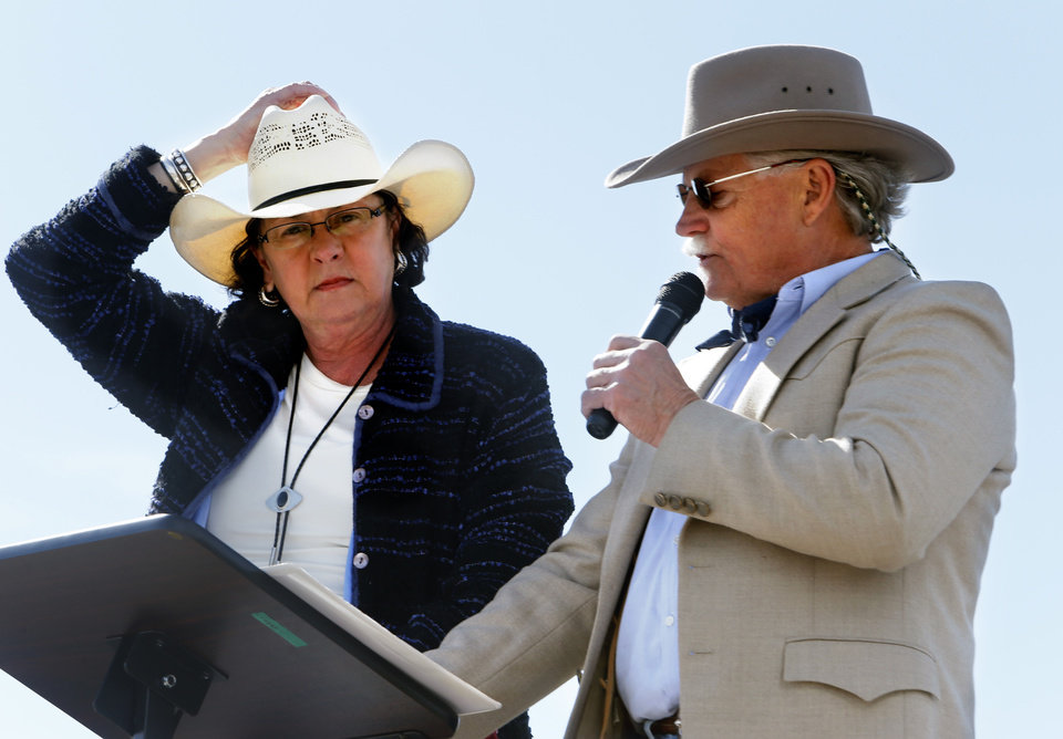 Hold on to your hats folks, as announcers Elizabeth and Rick heath are masters of ceremony in gusty winds for the 89er Day Parade on Saturday, April 20, 2013 in Norman, Okla.  Photo by Steve Sisney, The Oklahoman