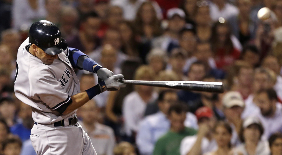 Photo -   New York Yankees' Derek Jeter swings on an RBI single off Boston Red Sox pitcher Junichi Tazawa during the seventh inning of a baseball game, Thursday, Sept. 13, 2012, at Fenway Park in Boston. (AP Photo/Charles Krupa)