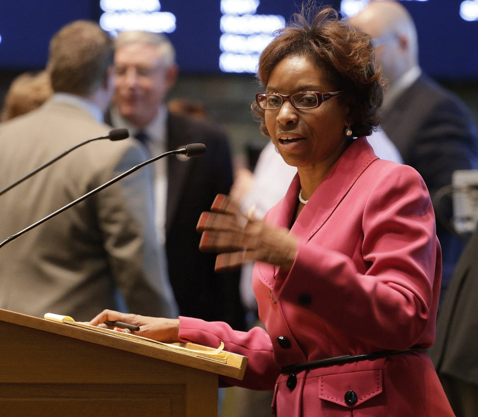 Photo - Rep. Rhonda Fields, D-Aurora,  urges House members to pass her bill on limiting the size of ammunition  magazines at the Capitol in Denver on Friday, Feb. 15, 2013. Kicking off a long, emotional debate about guns, Colorado lawmakers clashed Friday over setting limits on the size of ammunition magazines, a proposal in a package of Democratic bills responding to mass shootings at a suburban Denver movie theater and a Connecticut elementary school.(AP Photo/Ed Andrieski)