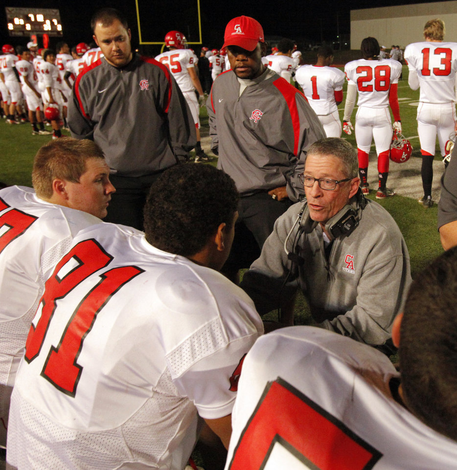 Photo - Carl Albert Titans head coach Gary Rose talks with players as his team plays the Del City Eagles in Class 5A first round playoffs high school football on Friday, Nov. 9, 2012 in Del City, Okla.   Photo by Steve Sisney, The Oklahoman
