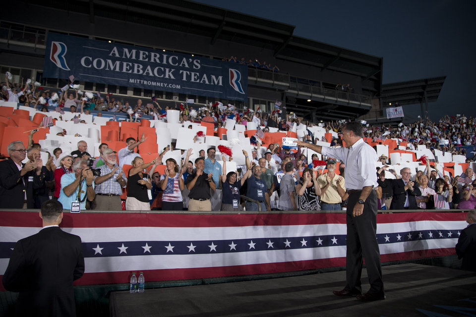 Photo -   Republican presidential candidate, former Massachusetts Gov. Mitt Romney arrives for a campaign rally on Friday, Sept. 7, 2012 in Nashua, N.H. (AP Photo/Evan Vucci)