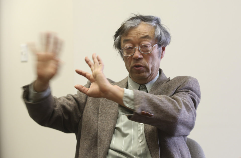 Photo - Dorian S. Nakamoto gestures during an interview with the Associated Press, Thursday, March 6, 2014 in Los Angeles. Nakamoto, the man that Newsweek claims is the founder of Bitcoin, denies he had anything to do with it and says he had never even heard of the digital currency until his son told him he had been contacted by a reporter three weeks ago. (AP Photo/Nick Ut)