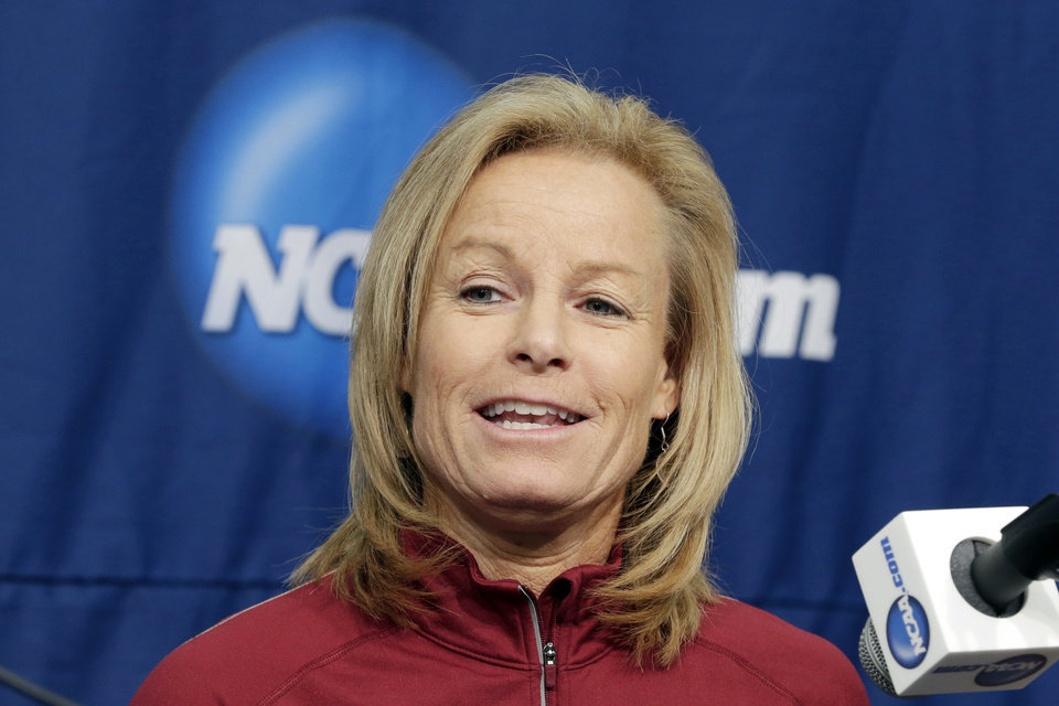 Photo - Florida State coach Sue Semrau speaks at a news conference in Ames, Iowa, Sunday, March 23, 2014. Florida State will play Stanford in the second round of the NCAA women's college basketball tournament in Ames on Monday. (AP Photo/Nati Harnik)