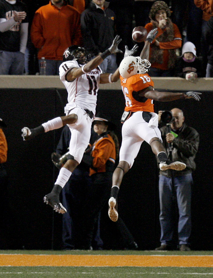 Photo - OSU's Perrish Cox (16) breaks up a pass intended for Texas Tech's Tramain Swindall (11) during the college football game between Oklahoma State University (OSU) and Texas Tech University at Boone Pickens Stadium in Stillwater, Okla. Saturday, Nov. 14, 2009. Photo by Sarah Phipps, The Oklahoman