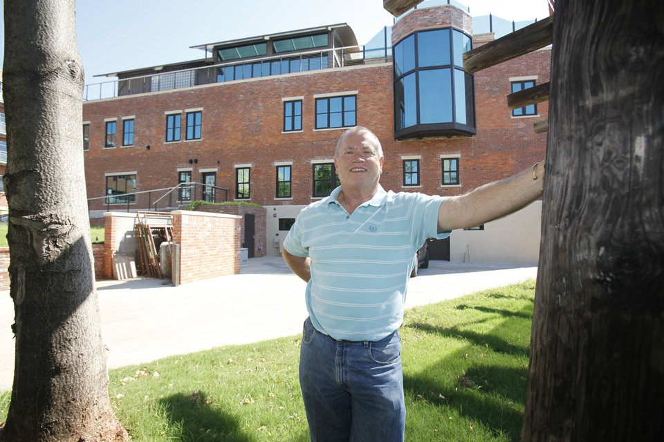 Photo - Larry Waters stands in front of his Clark Building in downtown Oklahoma City, OK, Tuesday, September 25, 2012.  By Paul Hellstern, The Oklahoman