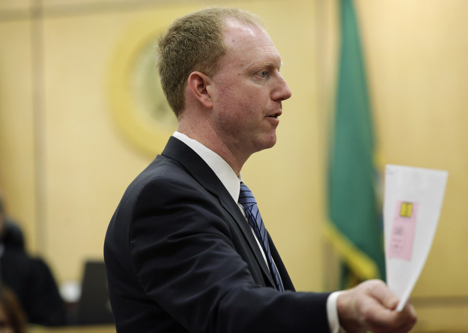 Photo -   Deputy prosecutor Grant Blinn shows the jury a photograph as he makes his closing statement in the voyeurism trial of Steve Powell, Tuesday, May 15, 2012, in Tacoma, Wash. Powell is the father-in-law of missing Utah mother Susan Powell. (AP Photo/Ted S. Warren)