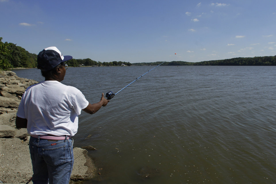 In this Sept. 12, 2012 photo, a woman fishes on Lake Decatur, which was built on the Sangamon River in the 1920s to serve the town and another local agricultural processor, in Decatur, Ill. As the drought of 2012 grew drier by the hot summer week, many Midwestern towns turned to water-use restrictions to preserve what they had. (AP Photo/Seth Perlman)