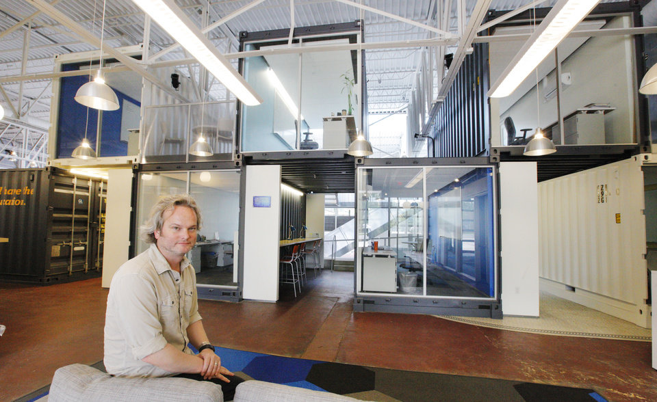 Photo -  Architect Brian Fitzsimmons sits in the former Chrysler building, now branded the Monterey, at 309 NW 13 St. in Oklahoma City. The building inside now uses shipping containers for offices.  Photos by Paul B. Southerland, The Oklahoman   PAUL B. SOUTHERLAND -  PAUL B. SOUTHERLAND