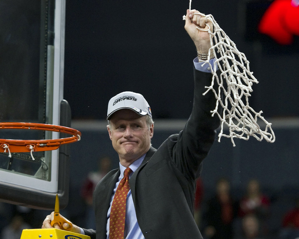 Photo - FILE - In this March 29, 2014, file photo, Central Missouri head basketball coach Kim Anderson acknowledges his team's fan base after cutting down the net after winning the the NCAA college Division II men's basketball championship against West Liberty in Evansville, Ind. Missouri announced Monday, April 28, 2014, that it has hired Anderson, a former star player and longtime aide to Norm Stewart, as its men's basketball coach. (AP Photo/The Evansville Courier & Press, Denny Simmons, File)