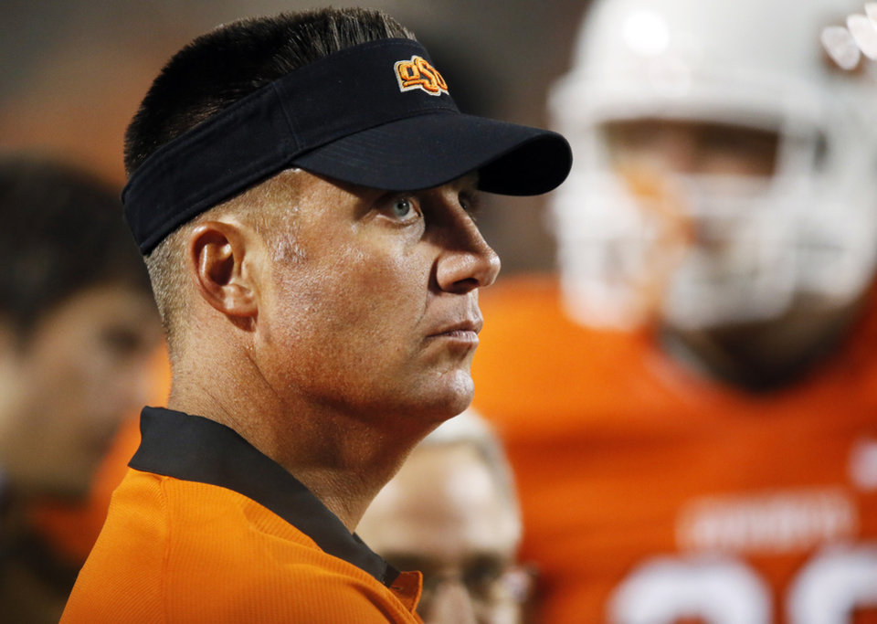 Photo - OSU head coach Mike Gundy watches from the sidelines during a college football game between Oklahoma State University (OSU) and Savannah State University at Boone Pickens Stadium in Stillwater, Okla., Saturday, Sept. 1, 2012. OSU won, 84-0. Photo by Nate Billings, The Oklahoman